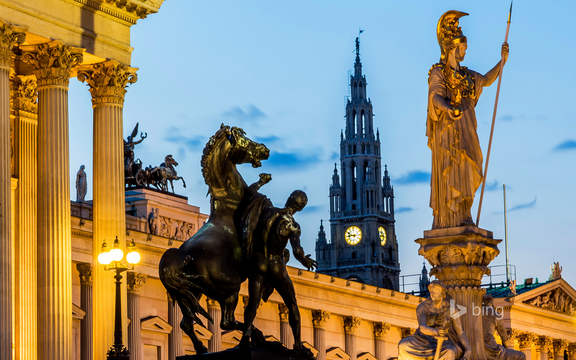 View to parliament building, town hall tower and statue of goddess Pallas Athene by twilight, Vienna, Austria